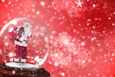 Santa asking for quiet in snow globe — Stock Photo