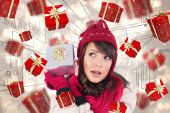 Young woman shaking her gift in order to gues — Stock Photo