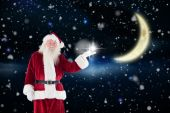 Santa shows something to camera — Zdjęcie stockowe