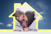 Beautiful couple wrapped in the duvet — Stock Photo