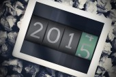 2014 changing to 2015 against tablet — Stock Photo
