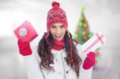 Festive brunette in winter clothes holding gifs — Stock Photo