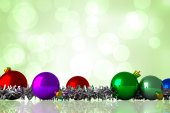 Composite image of christmas baubles and tinsel — Fotografia Stock