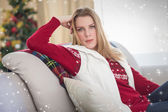 Cute blonde sitting on couch — Stockfoto