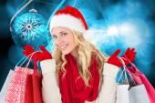 Festive blonde with shopping bags — ストック写真