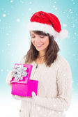 Brunette opening christmas gift — Stock Photo