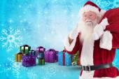 Santa gillar att bära sin säck — Stockfoto