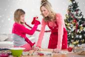Festive mother and daughter making cookies — Stockfoto