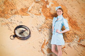 Pretty air hostess with hand on hip — Stock Photo