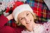 Festive blonde smiling on blanket — Stock fotografie