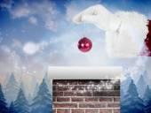 Santas hand is holding Christmas bulb — Stock Photo