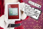 Santa claus showing tablet pc — Stock Photo