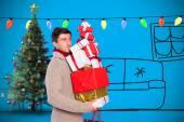 Man with many christmas presents — Stok fotoğraf