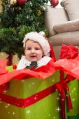 Baby boy in large christmas present — Stock Photo