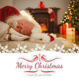 Santa claus resting on the rug — 图库照片