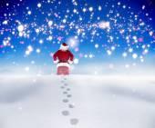 Санта, идущий в снегу — Стоковое фото