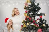 Mother and daughter decorating tree — Stock Photo