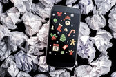 Christmas graphics against smartphone — Stock Photo
