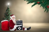 Santa sits with board — Foto de Stock