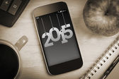 2015 against overhead of smartphone — Stock Photo