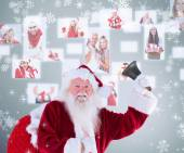 Happy santa ringing a bell — Stock Photo