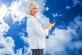 Happy mature woman sending a text — Stock Photo
