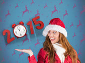 Festive redhead presenting with hand — Stock Photo
