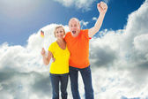 Happy german couple cheering — Stock Photo