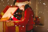 Festive little girl opening a glowing christmas — Stock fotografie