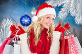 Festive blonde with shopping bags — Stok fotoğraf