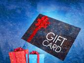 Flying gift card and presents — Stock Photo