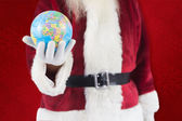 Santa has globe in hand — Stock Photo