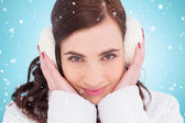 Pretty brunette with ear muffs — Stock Photo
