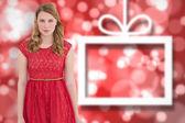 Beautiful woman wearing red dress smiling — Stock Photo