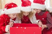 Festive little siblings looking at gift — Stock fotografie