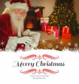 Smiling santa claus holding scroll — Foto de Stock