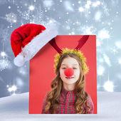 Festive little girl wearing red nose — Stockfoto
