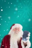 Santa Claus shows smartphone — Foto de Stock