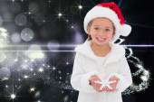 Composite image of festive little girl holding snowflake — Stockfoto