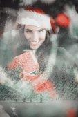 Festive brunette pressing gift at christmas — Stock Photo