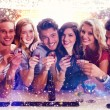Composite image of friends with drinks — Stock Photo #62510289