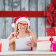 Festive blonde writing her christmas list — Stockfoto #62510457