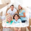 Smiling family packing boxes — Stock Photo #62510577
