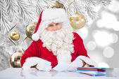 Composite image of santa writing cards — Foto de Stock