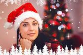 Festive brunette wearing a santa hat — Foto Stock