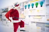 Santa jumps with his bag — Stock Photo