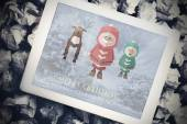 Santa elf and reindeer against tablet — Stockfoto