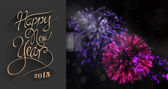 New year greeting against fireworks — Stock Photo