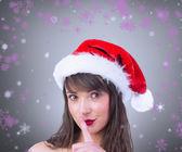 Festive brunette keeping a secret — Stock Photo