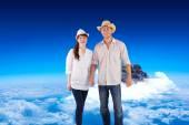 Smiling couple both wearing hats — Stock Photo